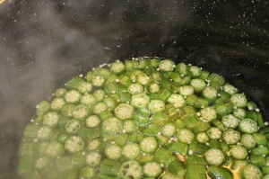 Pour hot fish stock over okra.
