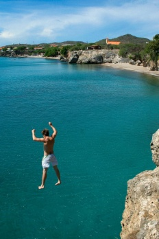 Norbert Dijk jumping off cliff at Playa Forti (Westpunt). Awesome photo by his brother, Vincent.