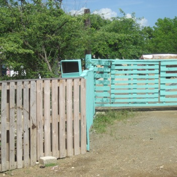Pallet fence seen near Playa Canoa. (Pallets are used for storage and transportation of cement, food etc)