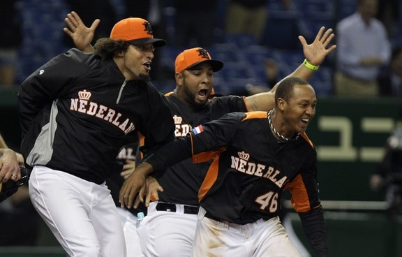 TOKYO, JAPAN - MARCH 11:  Jonathan Schoop # 46, Wladimir Balentien # 4 and other players of Netherlands celebrates victory over Cuba in the World Baseball Classic Second Round Pool 1 game between Cuba and the Netherlands at Tokyo Dome on March 11, 2013 in Tokyo, Japan.  (Photo by Chung Sung-Jun/Getty Images)