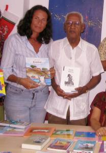 The author, Ariadne Faries, with Elis Juliana (qepd) presenting his children's books in 2006.
