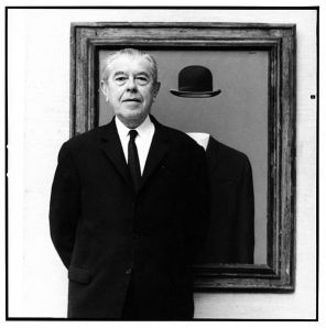 Photograph of Rene Magritte, in front of his painting The Pilgrim, as taken by Lothar Wolleh. Source: http://www.masters-of-photography.com/W/wolleh/wolleh_magritte_full.html.