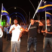 Churandy Martina and our 2012 Olympians waving our flag.