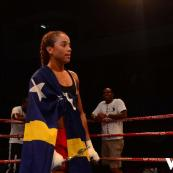 Jemyma Betrian, The Golden Girl from Curacao, wrapping herself in our flag after her boxing win.