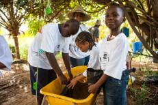 Kids learning how to plant at 'Finca Del Sol' organic farm.