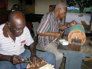 Serapio Pinedo studding the cylinder, his friend, the wiri player Lorenzo 'Tou' Sambo' helps.