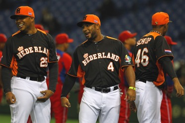 Source: Getty Images by way of sportsonearth.com. Coco (middle) and Andruw Jones representing the Netherlands during the World Baseball Classic 2013.