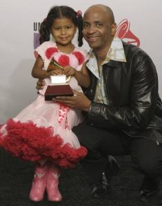 Sergio George and daughter Viveli with 'Producer of the Year' Grammy  in 2008. Source: www.nydailynews.com.