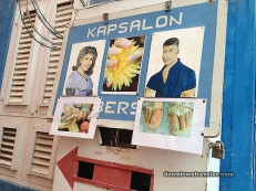 Hand-painted Hair / Nail Salon + Barber Shop sign adds special charm.