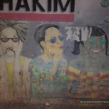 "This ""See No Evil"" mural is an ad for Optika Hakim (a local eye glass store). Please note that all the characters are wearing sunglasses, shielding them from 'evil' :)"