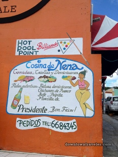 """Leslie writes: """"This ad for Nena's Dominican restaurant in Willemstad caught my eye. They are clearly targeting diners who like their women with curves!"""" Also please note that they serve Presidente 'Bon Friw!' (Papiamentu)"""