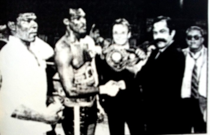 Ibi collecting one of his championship belts (early 1990s).