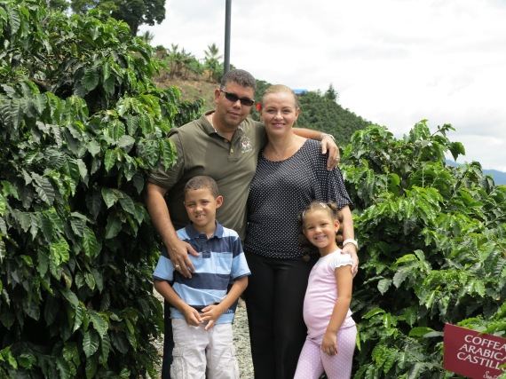 Cedric and Nanda Sprock and their 2 adorable kids surrounded by Coffee Beans in Colombia.